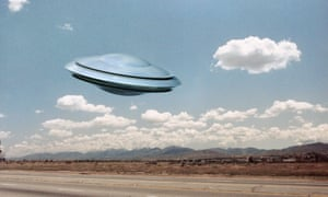 Illustration of a UFO flying saucer above a highway.