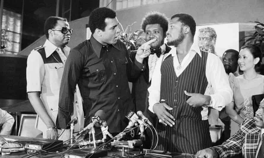 Muhammad Ali and Joe Frazier enjoy each other's company in July 1975.