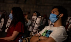 People watch marionette dolls at a concert in the Puppet Theater at El-Sawy Culture Wheel, Cairo, Egypt. Today, El-Sawy Culture Wheel resumed its cultural events with a puppet show and announced that the concert complies with the precautionary measures against coronavirus.