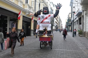 A gorilla puppet dressed in Peru's national soccer team jersey is seen before the public broadcast at city's square.