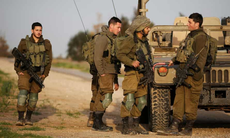 Israeli soldiers near the border fence with the southern Gaza Strip.
