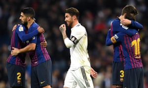 Sergio Ramos walks past celebrating Barcelona players after Real Madrid's second defeat to the Catalan side in a week.