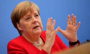 Angela Merkel praised the young climate crisis protesters for accelerating the global debate on environmental policy.