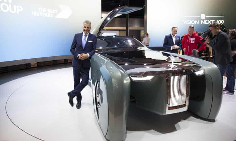 Rolls-Royce's chief executive, Torsten Müller-Ötvös, poses next to the Vision Next 100.