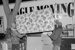 Workers for Milwaukee removals firm Eagle Moving empty a house in the city. A significant portion of the company's business now comes from eviction moves.