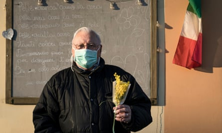 A man with a bouquet in San Fiorano, Italy