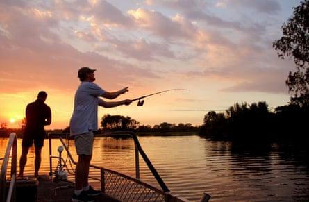 Barramundi fishing at sunset on a Yellow Water fishing tour.