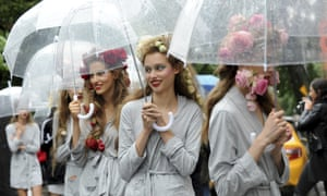 Models keep dry at a rehearsal for the Rodarte fashion show