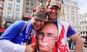 A Russian football fan wearing a T-shirt bearing an image of Vladimir Putin