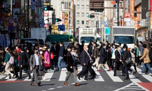 Pedestrians crossing a street in Tokyo today.
