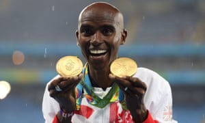 Mo Farah holding two Olympic gold medals