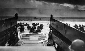 US Army troops wading ashore at Omaha Beach in north-western France, during the D-Day invasion, 6 June 1944.