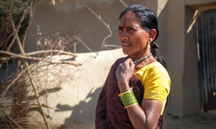 Nirupabai, a Kawar Adivasi woman, stands next to her home which was demolished nine days later in February 2014 for the expansion of the Kusmunda mine