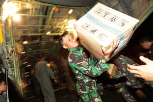 Military personnel unload aid logistics from a military plane at Mutiara Sis Al Jufri Airport in Palu on Monday.