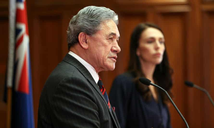 Jacinda Ardern and New Zealand First leader Winston Peters speak to media during the signing of a coalition agreement on Tuesday.