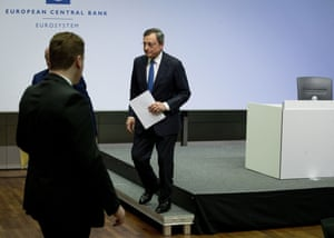 President of European Central Bank Mario Draghi leaves the podium after chairing his final governing council meeting