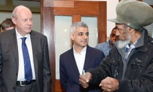 Work and pensions secretary Damian Green (left), with mayor of London Sadiq Khan, talk to Byron Mullings at a centre for people with disabilities, as part of an announcement of devolution of powers to London boroughs.