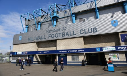 Supporters are photographed outside the Den prior to a League One match.