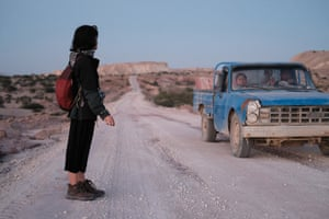 Che hitchhikes from Hengam village back to the camp. Hengam island. Iran