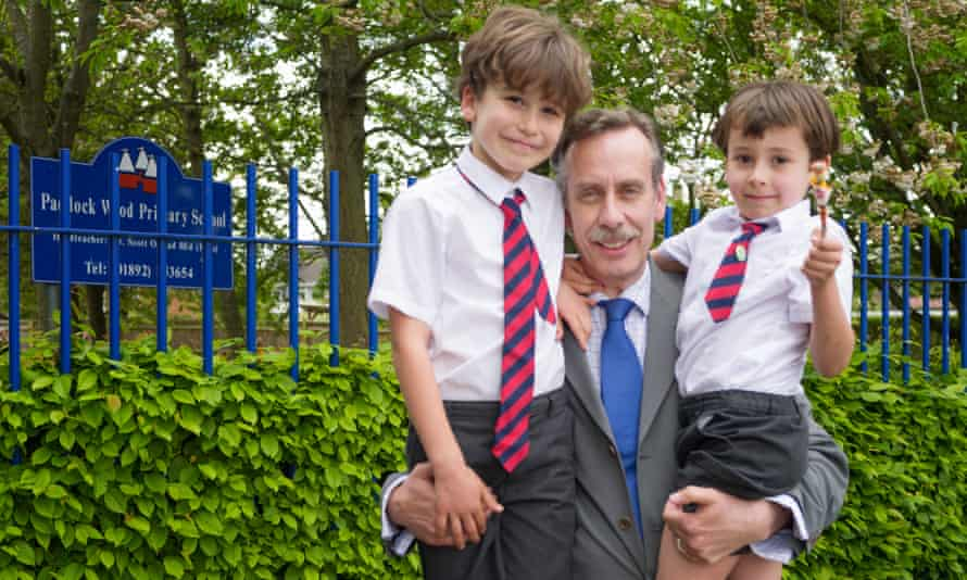 Charles Marshall at Paddock Wood primary school in Kent with his sons James, seven, and Richard, five