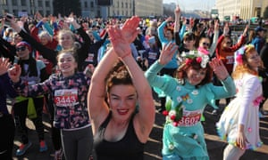 Participants in the Beauty Run, marking International Women's Day, warm up before dashing down Nezavisimosti Avenue in Minsk, Belarus