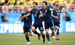 Yuya Osako of Japan celebrates scoring their second goal.