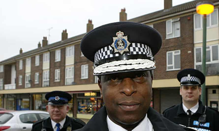 Police officer standing with community support officers