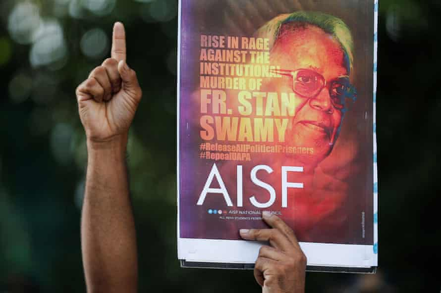 A person holds up a placard at a protest in Mumbai this month to show solidarity with Father Stan Swamy, who died while awaiting bail