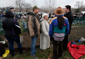 Jeff Ludlam wears a Russian lynx fur coat and wife Lisa Ludlam of Oklahoma City wears a snow leopard fur coat as she stands in a standing room area on the grounds of the US Capitol