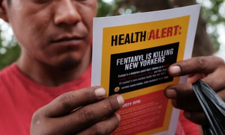 A man reads a leaflet on fentanyl.