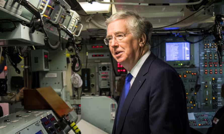Defence Secretary Michael Fallon in the control room onboard Vanguard-class submarine HMS Vigilant, as a further £640m spending on four new Trident boats is confirmed.