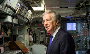 Defence secretary Michael Fallon in the control room on board Vanguard-class submarine HMS Vigilant