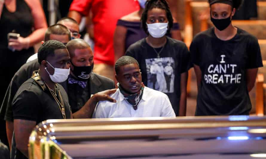 Houston rapper Cal Wayne looks at the casket during a public visitation for George Floyd at the Fountain of Praise church, in Houston, Texas.