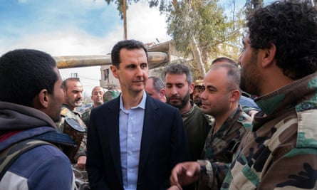 Syrian president Bashar al-Assad talking with government troops in eastern Ghouta