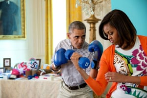 Barack and Michelle Obama pose for photos for her exercise initiative.