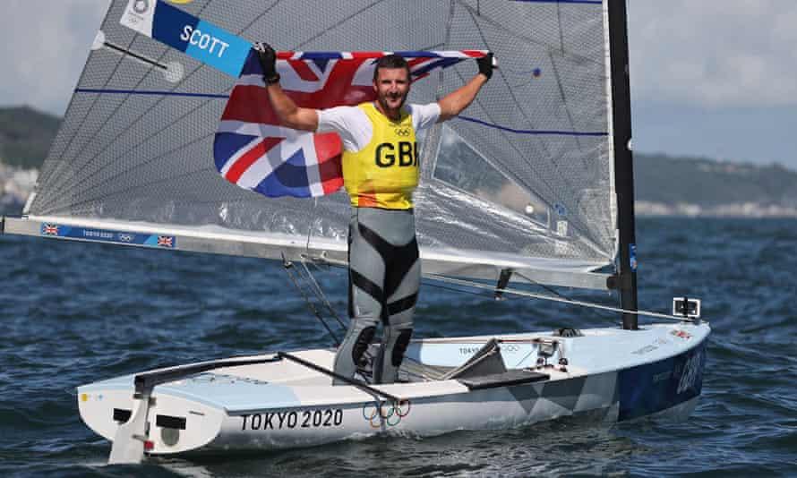 Giles Scott of Britain celebrates winning gold in the men's Finn