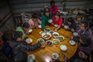 After a day at the plantations, a group of workers have dinner together