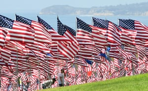 Malibu, USVisitors walk through the Pepperdine Wave of Flags, a display of 2,977 flags at Pepperdine University, California, to commemorate those who died in the 9/11 attacks