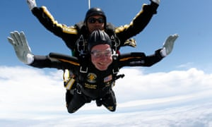 Bush celebrates his 85th birthday by jumping with the army's golden knight parachute team on 12 June 2009.