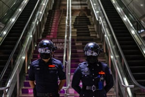 Kuala Lumpur, Malaysia. Malaysian officers wear smart helmets to measure the body temperature of train passengers after the country tightened coronavirus restrictions in some areas