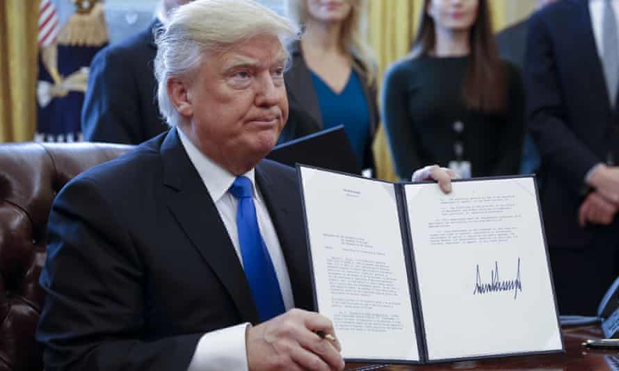 Donald Trump shows off executive orders on oil pipelines