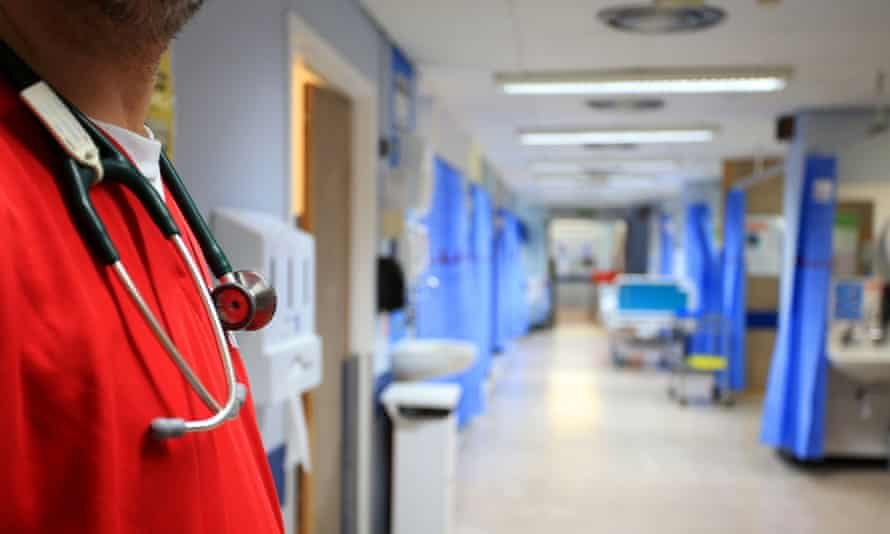 healthcare worker stands in a ward