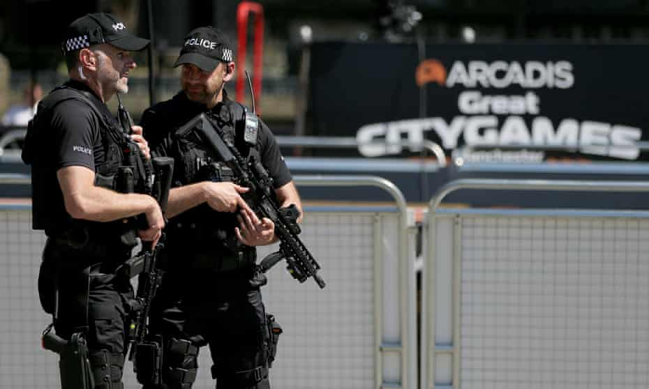 Armed police patrol in Manchester