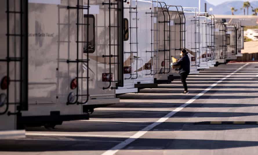 An LA county health department employee prepares trailers amid the coronavirus pandemic.