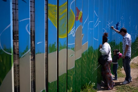 People at the US-Mexico border fence at Friendship Park in Playas de Tijuana, Baja California