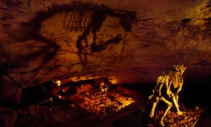 The skeleton of an extinct marsupial lion (Thylacoleo carnifex) casts a large shadow on the cave wall at an archaeological dig in Naracoorte Caves national park in South Australia.