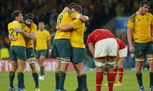 Australian players celebrate their victory after the final whistle.