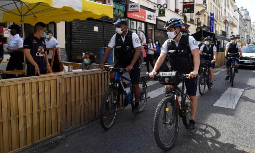 Police officers on patrol in Paris to check the use of the mandatory health pass
