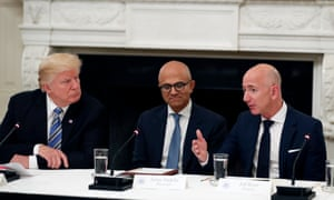 Donald Trump, Microsoft's Satya Nadella and Bezos at a roundtable event in the White House last year.