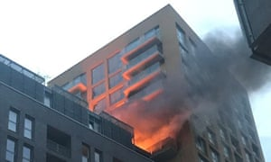 Flames rise from a 20-storey tower block in Elmira Street, Lewisham, south London.